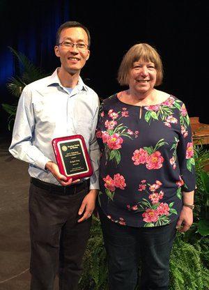 2019 Ann Palmenberg Junior Investigator Award winner, Zongdi Feng with Ann Palmenberg.